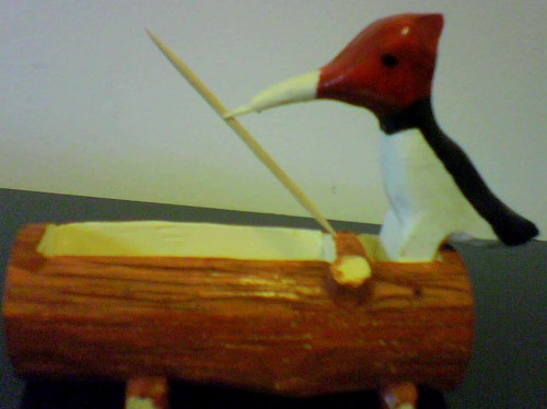 wood pecker pickes up a tooth pick, basswood painted and finished with lacker.